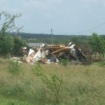 The remains of a family's home and truck.