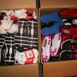 Boxes getting packed full with shoes socks n undies for shipping