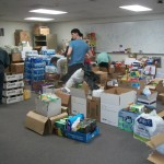 Working with the youth boxing food for families were delivering to that have no means to get to the community center.