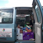 Loading Goodthinking 4 Al Our Relations van to deliver to those without means to get to community center