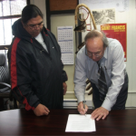 Signing partnership with St Francis Indian School Superintendent.
